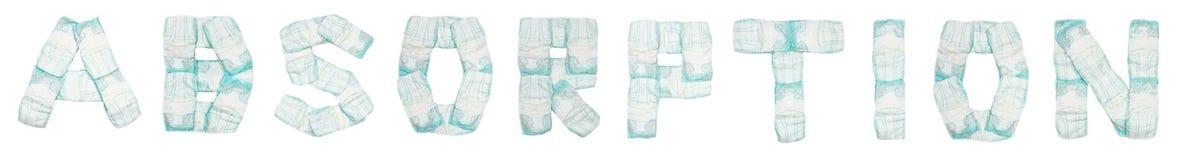L'absorption de Word a présenté des couches-culottes de bébé sur un fond blanc, isolat, serviette, inscription photo libre de droits