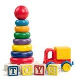 L'accumulazione dei giocattoli su background Fotografia Stock Libera da Diritti