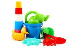 L'accumulazione dei giocattoli su background Fotografia Stock