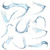 L'acqua blu spruzza su fondo bianco Fotografia Stock Libera da Diritti