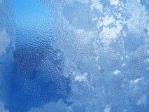 L'acqua cade il gelo di conclusione sulla finestra Fotografie Stock