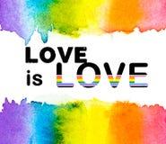 L'acquerello dell'arcobaleno con AMORE è testo su un fondo bianco, il gay pride LGBT di AMORE, contro distinzione omosessuale royalty illustrazione gratis