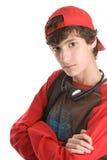 L'adolescente con le braccia ha attraversato Fotografia Stock