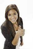 L'adolescente donnant les pouces lèvent le signe images stock