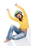 L'adolescente femminile gode della musica con le cuffie Immagini Stock