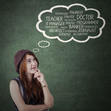 L'adolescente femminile immagina il suo lavoro futuro Immagini Stock