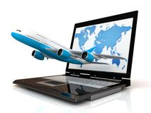 L'aereo ed il computer portatile Fotografia Stock