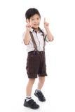 L'affare asiatico sveglio uno di rappresentazione del bambino ottiene un segno della carta bianca Immagine Stock
