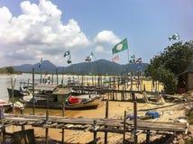 L'affiche et le drapeau luttent pendant l'élection générale 2012 de la Malaisie Image libre de droits