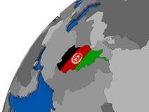 L'Afghanistan avec le drapeau sur le globe politique Photos stock