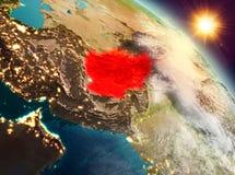 L'Afghanistan dans le lever de soleil de l'orbite Photographie stock libre de droits