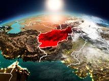 L'Afghanistan dans le lever de soleil de l'orbite Photos stock