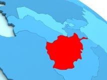 L'Afghanistan en rouge sur le globe bleu Photographie stock libre de droits