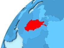 L'Afghanistan en rouge sur le globe bleu Photographie stock