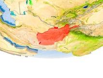 L'Afghanistan en rouge sur le modèle de la terre Photos stock