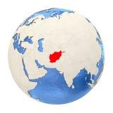 L'Afghanistan en rouge sur le plein globe d'isolement sur le blanc Photos stock