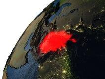 L'Afghanistan en rouge sur terre la nuit Photographie stock libre de droits