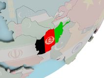 L'Afghanistan sur le globe avec des drapeaux Photos stock