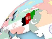 L'Afghanistan sur le globe avec le drapeau Image stock