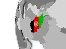L'Afghanistan sur le globe avec le drapeau Photographie stock libre de droits