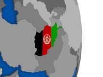 L'Afghanistan sur le globe avec le drapeau Photos stock