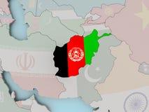 L'Afghanistan sur le globe politique avec le drapeau Photos stock