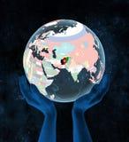 L'Afghanistan sur le globe politique dans des mains Illustration de Vecteur