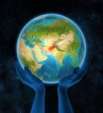 L'Afghanistan sur terre dans des mains dans l'espace Illustration Libre de Droits