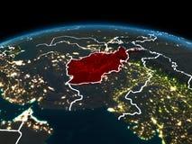 L'Afghanistan sur terre la nuit Image stock