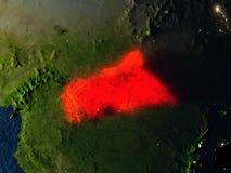 L'Afrique centrale en rouge de l'espace la nuit Photographie stock libre de droits
