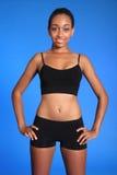 L'afroamericano atletico adatto mette in mostra il torso della donna Immagini Stock Libere da Diritti