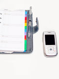 l'agenda de cellules objecte le téléphone de crayon lecteur de bureau Photographie stock libre de droits
