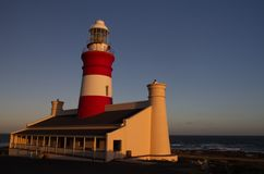 L Agulhas Ligthouse at the most southern point in Africa, during sunset. Cape Agulhas lighouse at the most southern point in Africa, during sunset Royalty Free Stock Photos