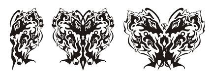 L'aile tribale de papillon a formé par la tête de lion et la tête d'aigle Photos libres de droits