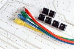 L'aiuto dell'IT, l'assistenza, la rete cabla il fondo del circuito Fotografia Stock Libera da Diritti