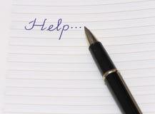 L'aiuto di parola scritto su un diario fotografie stock libere da diritti