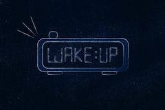 L'alarme de Digital avec le mot se réveillent au lieu du temps Photo stock