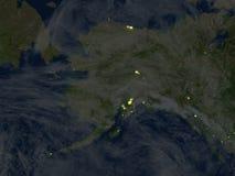 L'Alaska la nuit sur terre de planète Photos stock