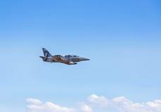 L-39 albatros fighter jet flying on blue sky Royalty Free Stock Photo