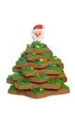 L'albero di Natale del pan di zenzero con Santa affronta Immagine Stock