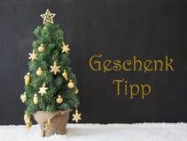 L'albero di Natale, Geschenk Tipp significa la punta del regalo, calcestruzzo nero Fotografia Stock Libera da Diritti