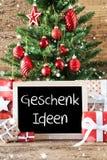 L'albero di Natale variopinto, i fiocchi di neve, Geschenk Ideen significa le idee del regalo Fotografie Stock Libere da Diritti