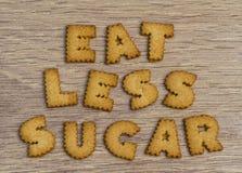 L'alfabeto a forma di dire dei biscotti mangia il meno zucchero Immagini Stock