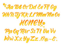 L'alfabeto latino mellifluo liquido con oro spruzza Mano che scrive l'insieme giallo di vettore delle lettere illustrazione di stock