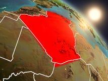 L'Algérie de l'espace pendant le lever de soleil illustration stock