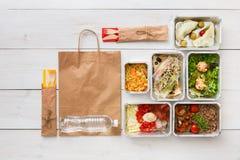 L'alimento sano porta via in scatole, vista superiore a legno Immagine Stock Libera da Diritti