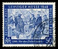 L'ALLEMAGNE - 7 mars 1948 : Timbre historique allemand : foire commerciale de Leipzig de ressort avec l'annulation spéciale, le 7 photos stock