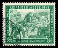 L'ALLEMAGNE - 7 mars 1948 : Timbre historique allemand : foire commerciale de Leipzig de ressort avec l'annulation sp?ciale, le 7 photos libres de droits