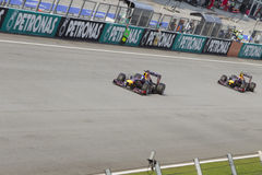 Avances Mark Webber de Sebastian Vettel Image stock