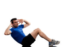 L'allenamento di esercitazioni di Abdominals dell'uomo spinge verso l'alto la posizione Fotografia Stock